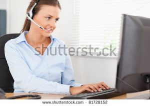 Shutterstock - stock-photo-a-businesswoman-with-headset-helping-a-customer-81728152